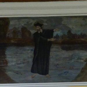 2. Obraz namalowany przez Józefa Brodnickiego w roku około 1920 przedstawia Bł. Bogumiła jak cudownie chodzi po wodzie- wylanej rzece Warcie i lud za sobą do kościoła prowadzi.
